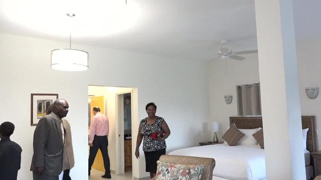 Invited guests tour one of the new at the new wing of the Mount Nevis Hotel on October 14, 2016
