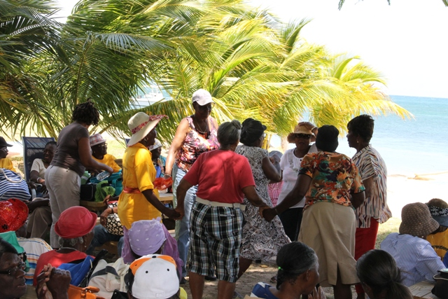 Seniors having fun at a picnic at Oualie Beach hosted by the Seniors Division in the Department of Social Services, Ministry of Social Development in the Nevis Island Administration