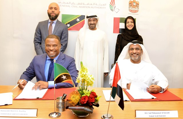 Foreign Affairs Minister in St. Kitts and Nevis Hon. Mark Brantley and His Excellency Saif Mohammed Al Suwaidi, Director General of the General Civil Aviation Authority (GCAA) signing the Agreement. Looking on are (standing l - r) C.G Hawley, Sheikh Ahmed bin Saeed Al Maktoum - Chairman of Dubai Civil Aviation Authority and CEO and Chairman of the Emirates Group and Chairman of Dubai World and Her Excellency Reem Al Hashimi - Minister of State and cooperation Managing Director of EXPO 2020.