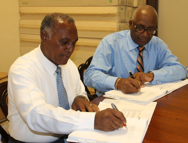 Premier of Nevis Hon. Vance Amory, on behalf of Minister responsible for Public Utilities Hon. Alexis Jeffers, signs an agreement with Wӓrtsilӓ representative, Rodney George, Vice President of Wӓrtsilӓ Caribbean, Inc. for the provision of a new 3.85 megawatt engine at the Nevis Electricity Company Limited's Board Room on Long Point Road on November 25, 2016