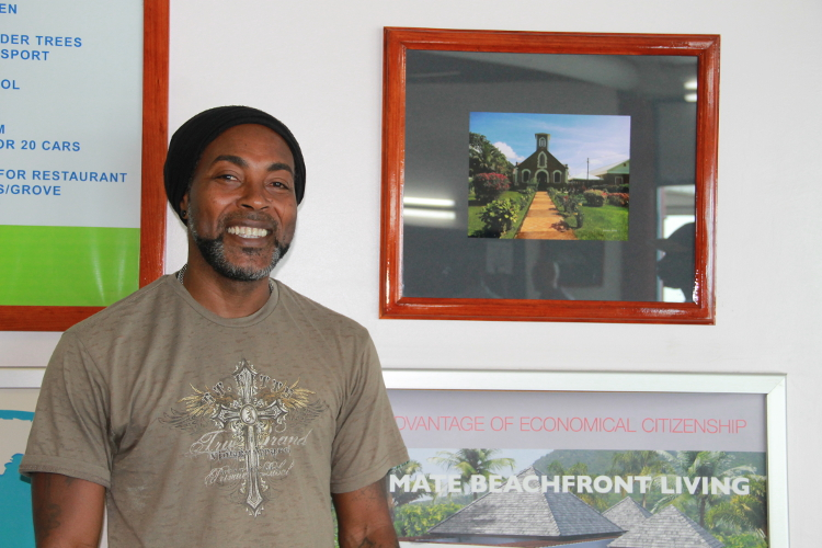 Photographer Sylvester Meade, the first winner of the Ministry of Tourism's Amateur Photographer of the Year contest with one of his winning entries on display at the Vance W. Amory International Airport (file photo)