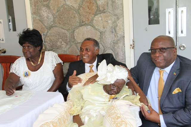 "Prime Minister of St. Kitts and Nevis Hon. Dr. Timothy Harris (r) and Premier of Nevis Hon. Vance Amory with birthday girl Celian ""Martin"" Powell of Zion Village on her 105th birthday with her only surviving child Dulcina Browne on January 19, 2017 at the Flamboyant Nursing Home"