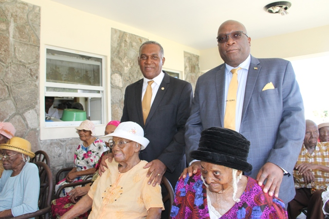 "(l-r) Premier of Nevis Hon, Vance Amory and Prime Minister of St. Kitts and Nevis Hon. Dr. Timothy Harris with centenarians (seated l-r) Mrs. Rosetta ""Rosie"" Morton from Rawlins and Mrs. Artemisia ""Etty"" Jeffers from Hickmans and other residents at the Flamboyant Nursing Home in Nevis on January 19, 2017"