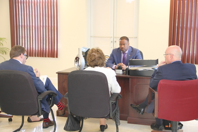 Hon. Mark Brantley, Deputy Premier of Nevis and Minister of Foreign Affairs in St. Kitts and Nevis in discussions with Baroness Joyce Anelay, Foreign Office Minister for the Overseas Territories in the United Kingdom and her team at his office at the Pinney's Industrial Site on January 11, 2016