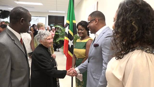 "Acting Premier of Nevis Hon. Mark Brantley flanked by (right) wife of Premier Hon. Vance Amory Mrs. Verni and (left) his wife Mrs. Sharon Brantley, meets with Accomplished British historian and author Dr. June Goodfield at the premier showing of her film ""The Time Detective"" based on her novel ""Rivers of Time"" at the Social Security's conference room at Pinney's on January 14, 2017, at a VIP event hosted by the Ministry of Tourism, in collaboration with Dr. Goodfield and the British Broadcasting Corporation. Looking on are John Hanley, Assistant Secretary in the Ministry of Tourism (in the foreground) and the film's Production Manager Helen Kidd"