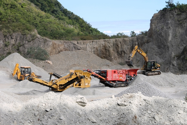 Stone crushing equipment in operation at the Nevis Island Administration-owned New River Quarry, paid for by a loan from the St. Christopher and Nevis Social Security Board to the Nevis Housing and Land Development Corporation