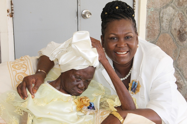"Celian ""Martin"" Powell of Zion Village, the Federation's oldest citizen with her granddaughter Erma Skelton at her 105th birthday celebration hosted by her family on January 19, 2017 at the Flamboyant Nursing Home"