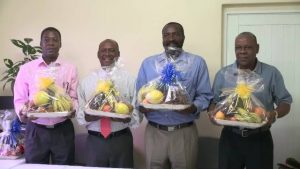 "The Nevis Customs and Excise Division honours retired Customs Officers with fruit baskets as a token of appreciation on International Customs Day at Long Point on January 26, 2017. (L-r) Lester Liburd, Oriel Hanley, Sévil Hanley and Denzil ""Chip"" Moven"