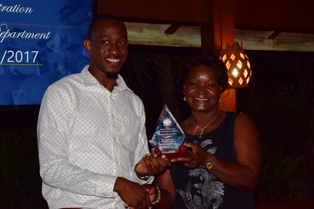 Jevon Claxton receiving the Field Technician of the Year Award from Mrs. Verni Amory, wife of the Premier of Nevis Hon. Vance Amory, at the 2nd Annual Information Technology Department Delta Awards Dinner at the Nisbet Plantation Beach Hotel on February 18, 2017