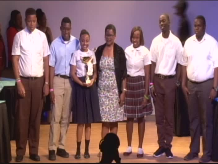 Team Nevis with their winning trophy for the 45th annual Leeward Island Debating Competition at the closing ceremony at the Nevis Performing Arts Centre on February 27, 2017