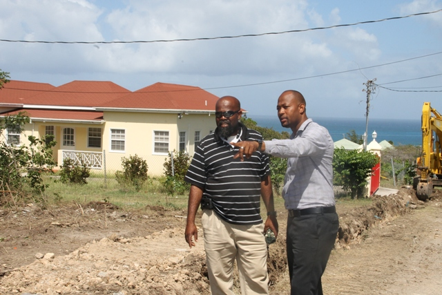 Raoul Pemberton, Director of the Public Works Department on Nevis and Daniel Williams, Supervisor for Roads in the Public Works Department on site at the Nevis Island Administration's Shaws Road Improvement Project on February 06, 2017