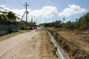 Laying upgraded water pipes at upper Shaws Road on February 06, 2017, part of the Ministry of Communications and Works in the Nevis Island Administration's Shaws Road Improvement Project