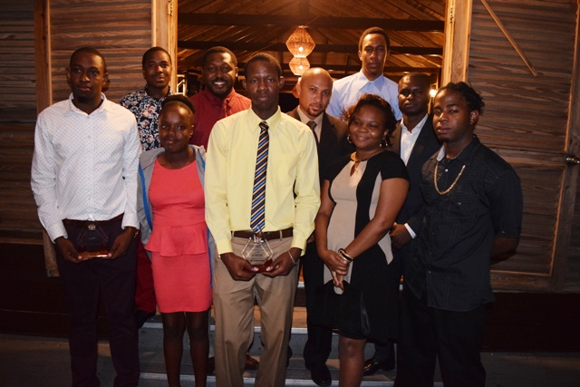 Director of the Information Technology Department Quincy Prentice (second row extreme right) and his staff at the department's 2nd Annual ITD Delta Awards Dinner at the Nisbet Plantation Beach Hotel on February 18, 2017