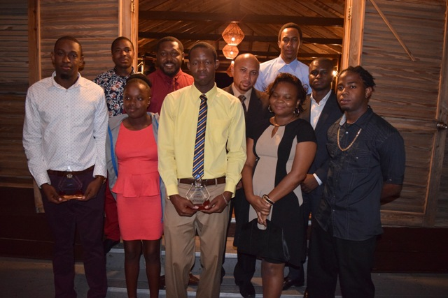 Jevon Claxton (front row extreme right) and Ezekiel Parris (front row second from left) showing off their awards with other members of staff of the Information Technology Department at the 2nd Annual Information Technology Department Delta Awards Dinner, at the Nisbet Plantation Beach Hotel on February 18, 2017