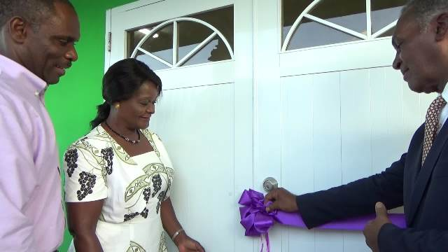 Premier of Nevis Hon. Vance Amory assisting his wife Verni, moments after she cut the ribbon at the official opening ceremony for the Joycelyn Liburd Primary School's cafeteria in Gingerland on February 14, 2017, while Mr. Colin Dore