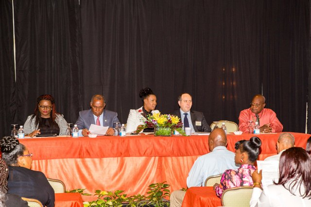Head Table participants (l-r) Moderator, Ms. Vincia Herbert, Premier of Nevis and Minister of Finance Hon. Vance Amory, Regulator of the Nevis Financial Services Department Ms. Heidi-Lynn Sutton, Facilitator, Mr. Stephen Platt and Regulator of International Banking James Simpson