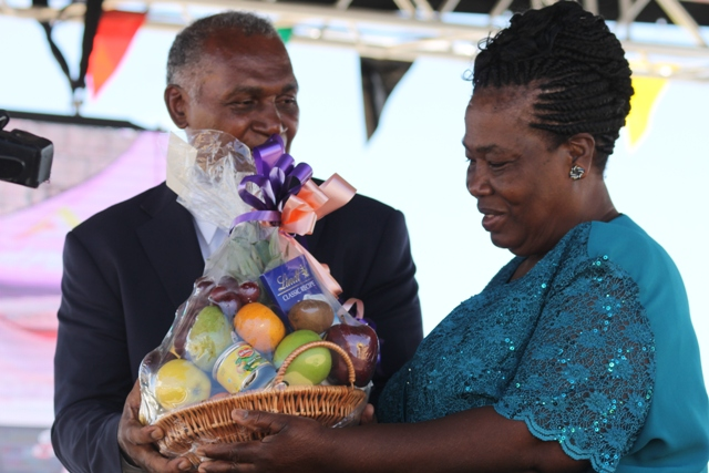 Premier of Nevis Hon. Vance Amory presents a plaque to Ms. Tyzena Brookes, Paton of the 23 Annual Department of Agriculture Open Day in recognition of 22 years of dedicated service to the department at the opening ceremony at the Villa Grounds in Charlestown on March 30, 2017