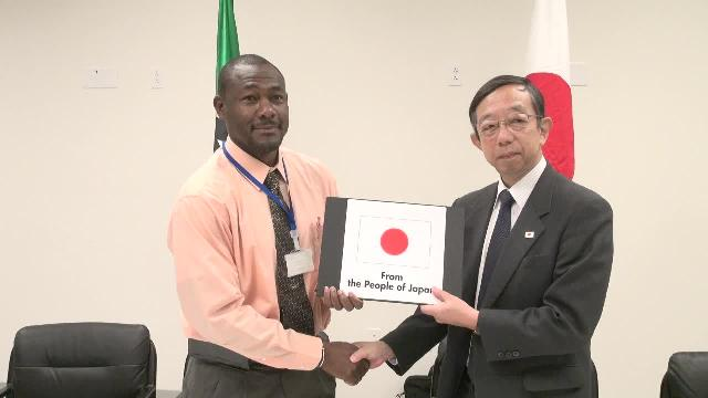 (l-r) Director of the Nevis Disaster Management Department Mr. Brian Dyer accepts documents for grant funds from Mr. Masatoshi Sato, Minister-Counsellor and Deputy Head of Mission at the Embassy of Japan to St. Kitts and Nevis at a signing ceremony at the Emergency Operations Centre, Long Point on March 15, 2017