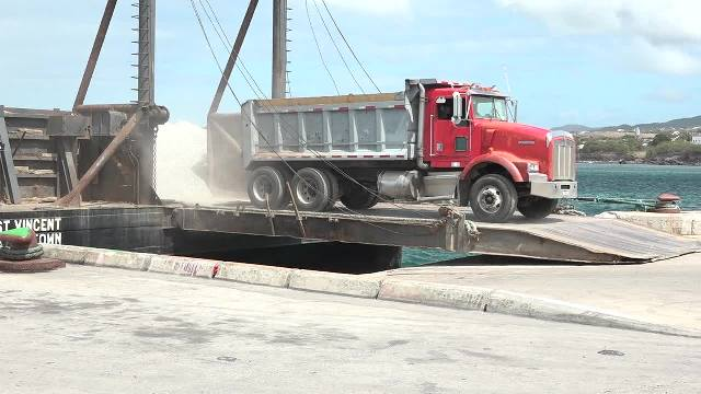 Some of the 3,000 tons of aggregate from the quarry at New River being offloaded on a barge at the Long Point Port on February 28, 2017