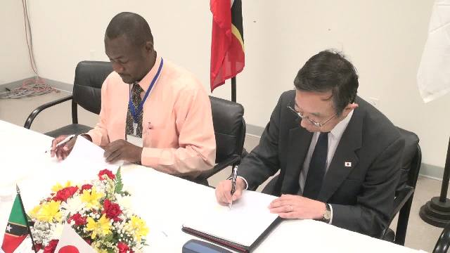 Mr. Masatoshi Sato, Minister-Counsellor and Deputy Head of Mission at the Embassy of Japan to St. Kitts and Nevis signs grant contract documents and Memorandum of Understanding with Director of the Nevis Disaster Management Department Mr. Brian Dyer at a signing ceremony at the Emergency Operations Centre, Long Point on March 15, 2017