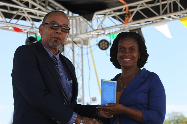 Mr. John King, Representative of IICA Delegations in the Eastern Caribbean States presents Principal of the Charlestown Primary School Ms. Latoya Jeffers for the school's Outstanding Work in Agricultural Innovation in 2016 at the 23rd Annual Agriculture Open Day at the Villa Grounds on Nevis on March 30, 2017