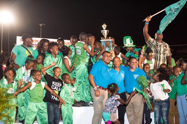 Victorious and jubilant St. Thomas Primary School athletes in the Class A Division of the 25th Gulf Insurance Primary School Championships, with Gulf Insurance Limited representatives, school staff and supporters at the trophy ceremony at the Elquemedo T. Willett Park on April 05, 2017 (photo courtesy Corner Stone)