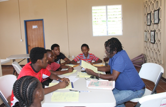 "Justin ""Hero"" Caslell, renowned Montserratian Calypsonian and Soca Artist and facilitator of a Calypso Writing Workshop on Nevis in session with junior calypsonians for the second day at the Hardtimes Community Centre on April 19, 2017"