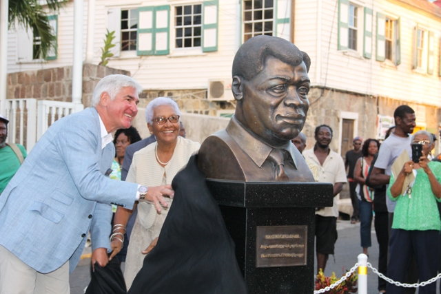"Wife of the late of the late the Right Excellent Dr. Sir Simeon ""Sim"" Daniel, the first Premier of Nevis and a National Hero and benefactor and family friend Mr. Michael Heinritzi unveil a bust of Dr. Sir Daniel's in honour in the heart of Charlestown on April 20, 2017"