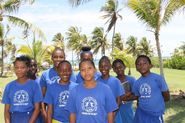 (Front) Hujay Jeffers, Grade 6 student of the Violet O. Jeffers Nicholls Primary School and fellow students at the Nisbet Plantation Beach Club on May 04, 2017, as part of the Ministry of Tourism's Hospitality Immersion exercise