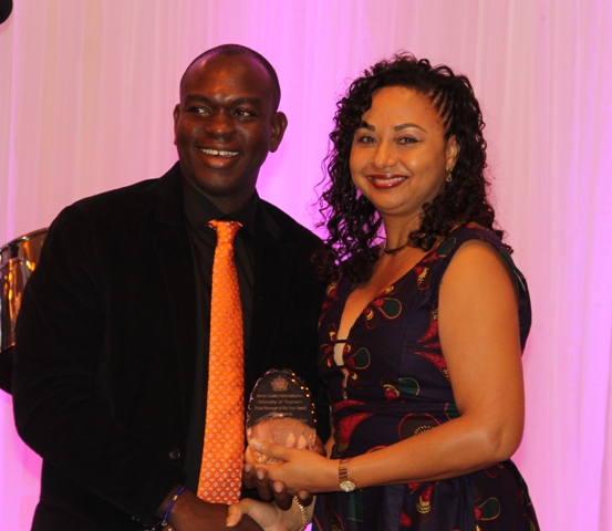 Kerry Hendrickson accepts the Ministry of Tourism's Hotel Manager of the Year Award from Mrs. Sharon Brantley, wife of Ministry of Tourism Hon. Mark Brantley, at the ministry's annual Tourism Awards Gala and Dance at the Four Seasons Resort on May 27, 2017