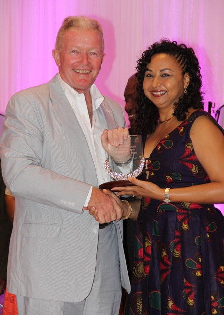 Tim Thuell, General Manager of the Nisbet Plantation Beach Club accepts the Ministry of Tourism's Hotel of the Year Award from Mrs. Sharon Brantley, wife of Ministry of Tourism Hon. Mark Brantley, at the ministry's annual Tourism Awards Gala and Dance at the Four Seasons Resort on May 27, 2017
