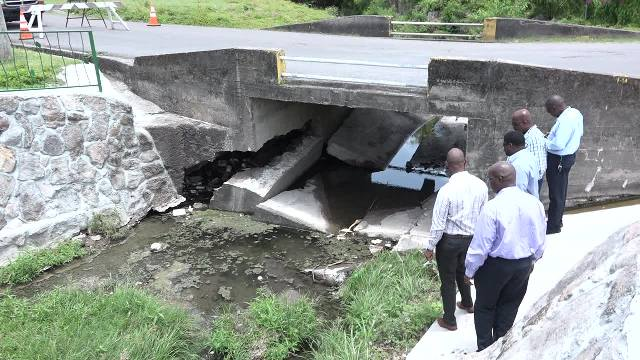 A team of officials from the Nevis Island Administration checking damage to the Bath Bridge on May 15, 2017, following recent heavy rains