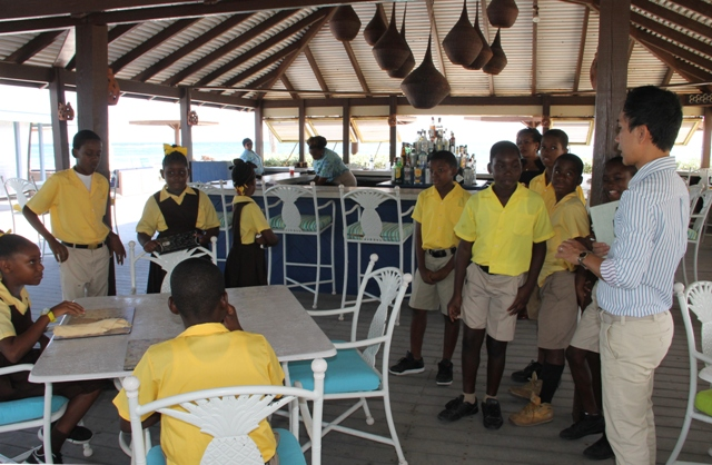 Students of the St. Thomas Primary School at the Nisbet Plantation Beach Club with Assistant General Manager Don Diaz on May 04, 2017, as part of the Ministry of Tourism's Hospitality Immersion exercise