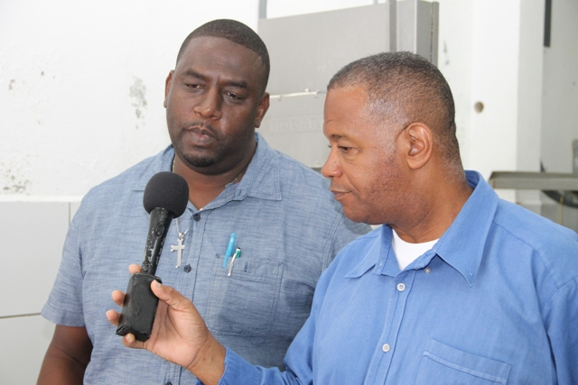 (l-r) Gary Griffin, Manager of the Department of Agriculture's Abattoir Division with Eric Evelyn, Permanent Secretary in the Ministry of Agriculture on Nevis