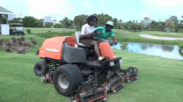 A student of the Gingerland Secondary School learns to use the grass cutter at the Four Seasons Resort on May 04, 2017, as part of the Ministry of Tourism's Hospitality Immersion exercise