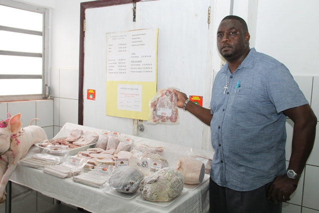 Gary Griffin, Manager of the Department of Agriculture's Abattoir Division showing off pork products ready for the Department of Agriculture's 2nd Annual Pork Festival