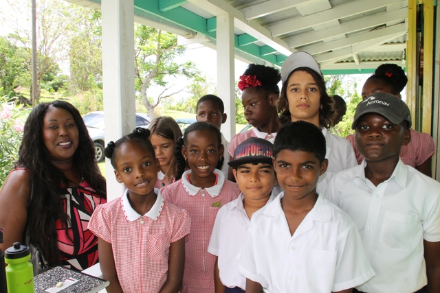Denise Morgan, Principal of the Montessori Academy Nevis with a group of Grade 4 and 5 students including Denise Summers (first row left), Alexandria Johnson (second row left) and Dylan Theron (second row right) at the Nevisian Heritage Village during the Ministry of Tourism's Open Day, a part of Exposition Nevis on May 11, 2017