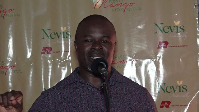 Greg Phillip, Chief Executive Officer of the Nevis Tourism Authority delivering remarks at the launch of the Nevis Mango and Food Festival at Chrishi Beach Club on May 28, 2017