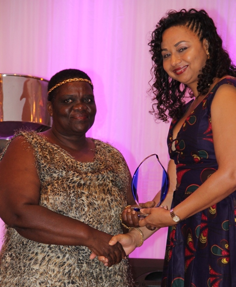 Rodney Elliott accepts the Ministry of Tourism's Best Nevisian Culinary Award from Mrs. Sharon Brantley, wife of Ministry of Tourism Hon. Mark Brantley, at the ministry's annual Tourism Awards Gala and Dance at the Four Seasons Resort on May 27, 2017