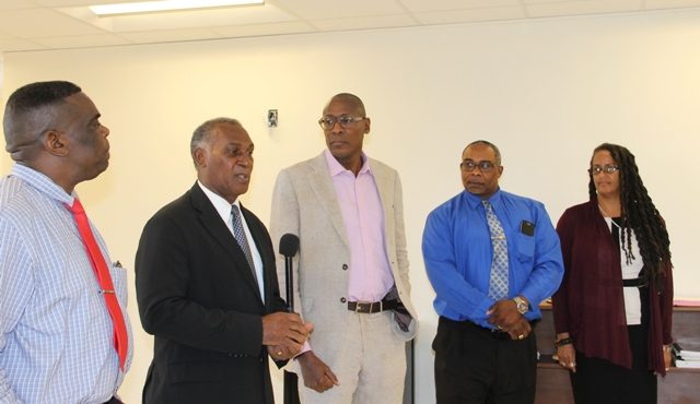 Hon. Vance Amory, Premier of Nevis (second from left) flanked by Antonio Maynard, Secretary General of the St. Kitts and Nevis National Commission for United Nations Education, Scientific Cultural Organization (extreme left), Dr. Keith Nurse, of the Sir Arthur Lewis Institute of Social and Economic Studies in Barbados (right), Jerome Rawlins, Chief Executive Officer of the Nevis Cultural Development Foundation (second from right) and Marlene Phillips, Research and Documentation Specialist at the St. Kitts Department of Culture (extreme right) at the end of a meeting at his Pinney's Estate office on May 31, 2017