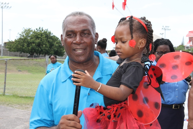 Hon. Vance Amory, Premier of Nevis and Minister of Education, with a pre-schooler at the end of the 32nd annual Child Month Parade at the Elquemedo T. Willett Park on June 09, 2017