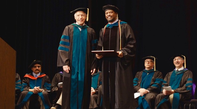 Hon. Mark Brantley, Deputy Premier of Nevis (right) with Dr. John P. Docherty, Chairman of the Board of Trustees of the Medical University of the Americas and the Saba University of Medicine, moments after he presented Mr. Brantley with an honorary Doctor of Laws degree at the commencement ceremony, at the Veterans Memorial Auditorium in Rhode Island, USA, on June 03, 2017