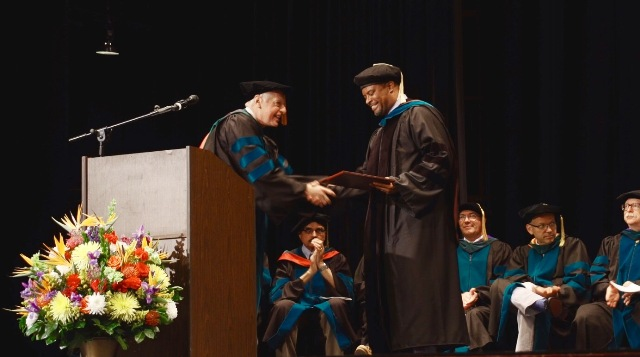 Dr. John P. Docherty, Chairman of the Board of Trustees of the Medical University of the Americas and the Saba University of Medicine presents Hon. Mark Brantley, Deputy Premier of Nevis, with an honorary Doctor of Laws degree at the schools commencement ceremony, at the Veterans Memorial Auditorium in Rhode Island, USA on June 03, 2017