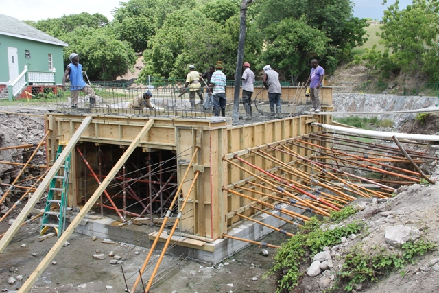Workmen in concrete operations on the new Bath Village Bridge on June 16, 2017
