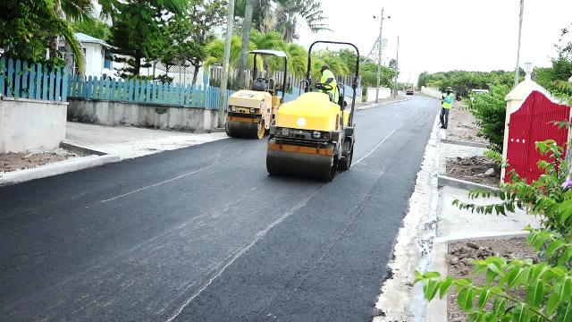 A section of the 2,400 feet of road being asphalted by workmen from the Public Works Department on Nevis on June 14, 2017