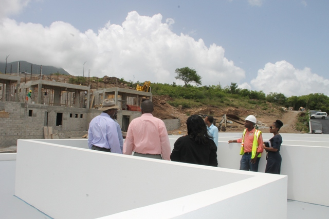 A team from the Ministry of Communication and Works and the Physical Planning Department visiting the Nevisian Sunset Project at Colquhoun Estate above the village of Cotton Ground on June 13, 2017
