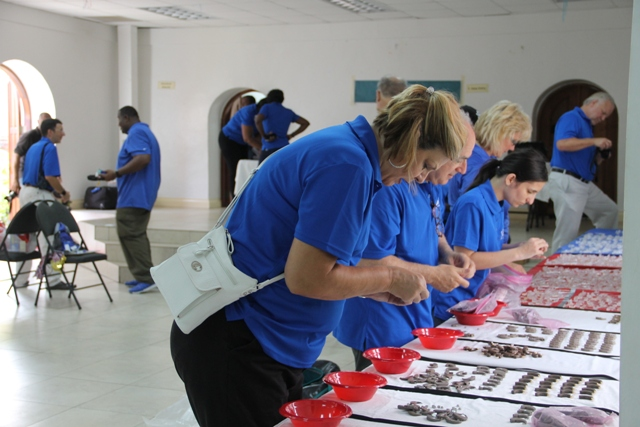 Members of the Starkey Hearing Foundation preparing hearing aids for fitting persons impaired hearing on their mission in Nevis at the Anglican Church Hall in Charlestown on June 08, 2017