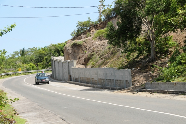 The completed rock retaining wall at Fenton Hill, part of the Nevis Disaster Management Department's Enhancing Disaster Resilience and Emergency Shelter Management Project