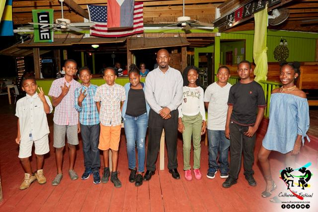 Participants in the Peachicks Junior Kaiso Competition with the contest coordinator Warren Moving
