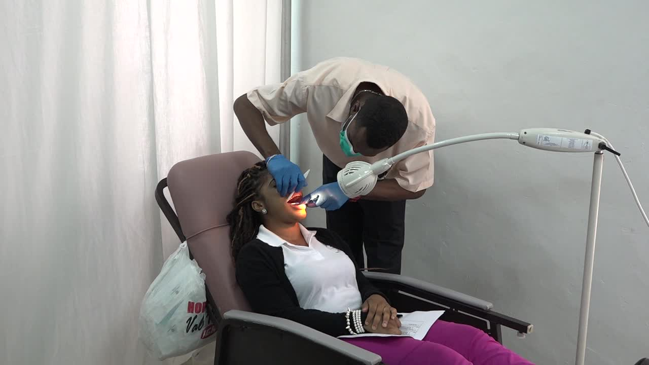 A dental screening for an attendee at the Barrels For Chance Inc. Health Fair at the St. Paul's Anglican Church Hall in Charlestown on July 28, 2017